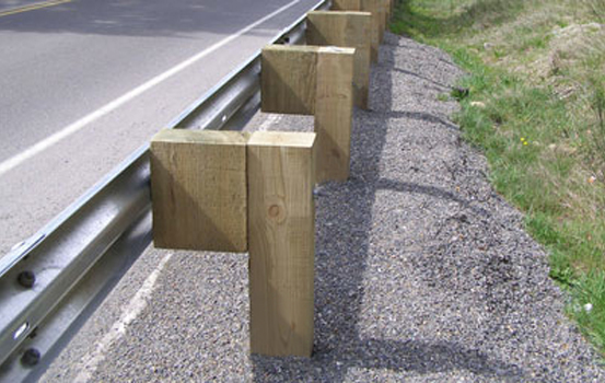 Steel guardrail posts blocks timber